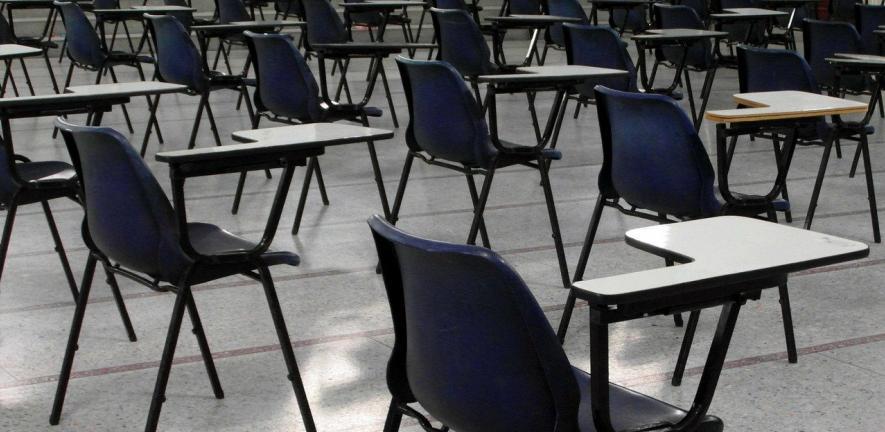 Photo of empty desks in an exam hall