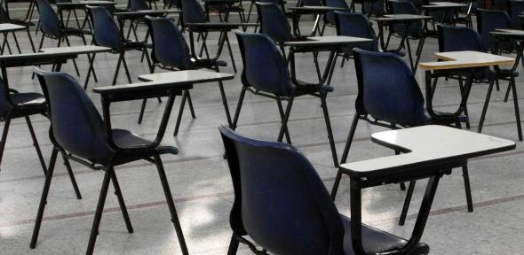 Photo of empty desks in an exam hall