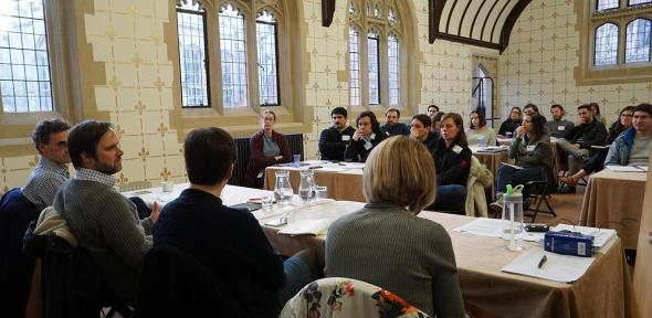 Participants at an Emerging Research Leaders Development Programme event seen from behind the panel members