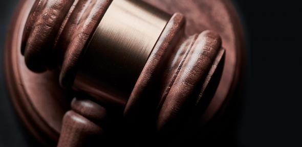 A judge's gavel resting on the bench