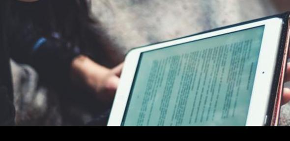 woman reading on an ebook reader